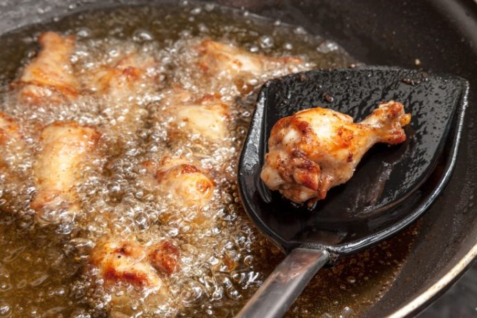 Fried chicken wings in the pan