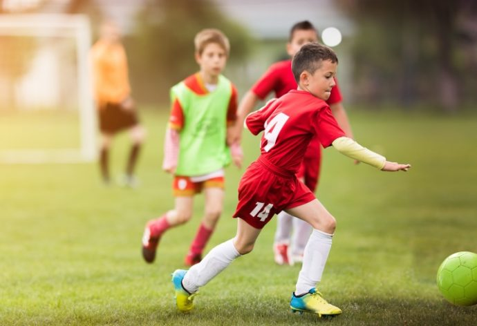 Kids soccer football – young children players match on soccer field