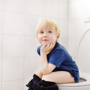 Cute little boy in restroom. Toddler child trainig use toilet. Hygiene for little child
