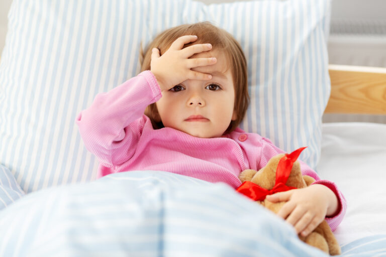 health, children and people concept - sick little girl lying in bed at home