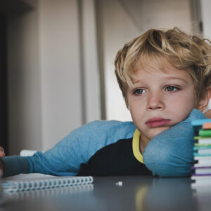 little boy tired exhausted stressed of reading, doing homework