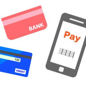 通帳とクレジットカードとスマホ キャッシュレスのイメージ