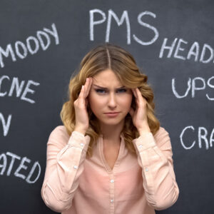 Woman suffering headache due to imaginary problems in pms, hormone imbalance